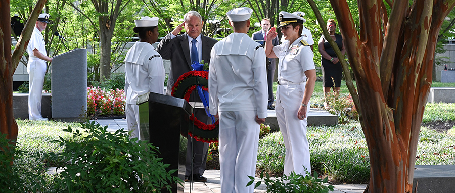 Office of Naval Intelligence (ONI) Commander Rear Adm. Kelly Aeschbach and retired Capt. Tom Bortmes lay a memorial wreath during a Sept. 11 remembrance ceremony at the National Maritime Intelligence Center.
